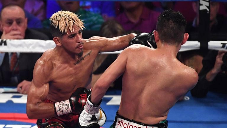 Dogboe produced a stellar performance to rip the title from Magdaleno (L)