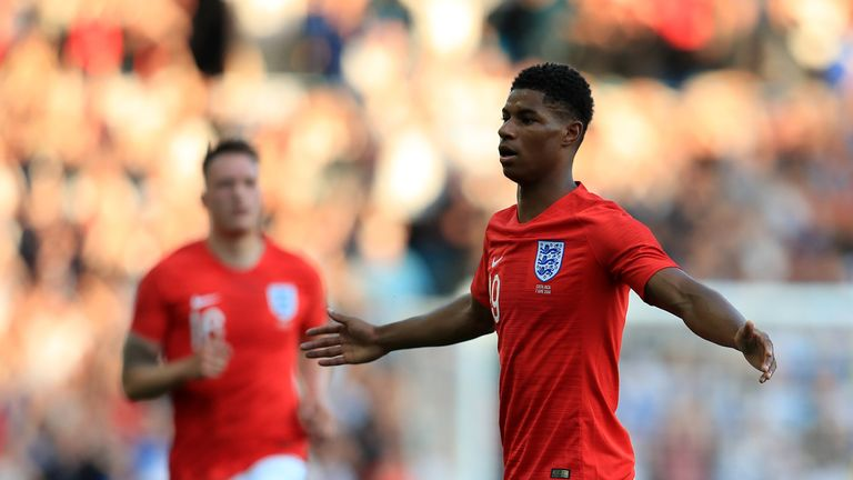 Marcus Rashford celebrates his goal against Costa Rica