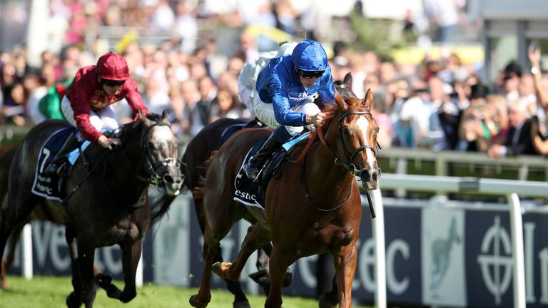 Masar ridden by jockey William Buick coming home to win the Investec Derby