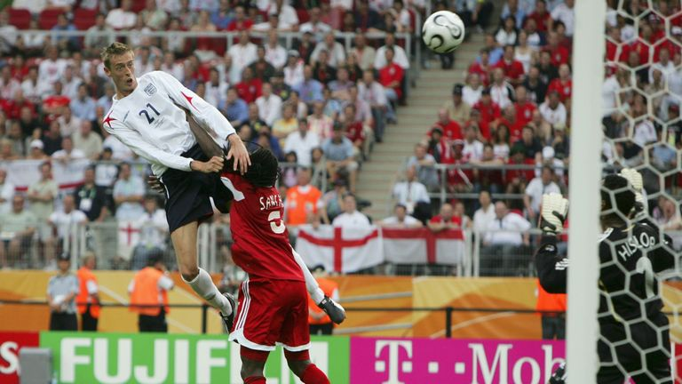 Peter Crouch rises to head home for England