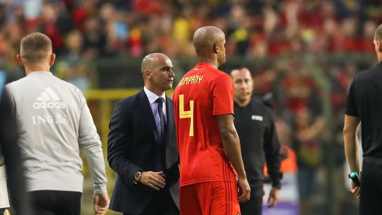 Roberto Martinez speaks with Vincent Kompany as he leaves the pitch