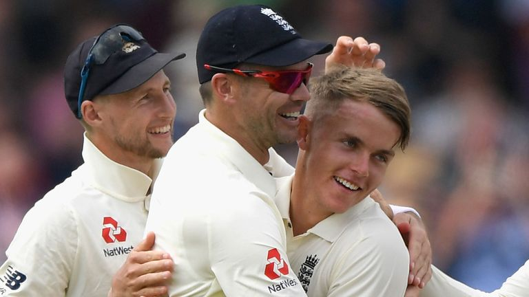 Sam Curran is congratulated by Joe Root and James Anderson after taking is first Test wicket