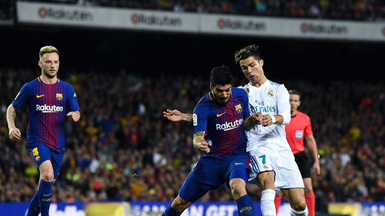 Luis Suarez (left) says his rivalry with Cristiano Ronaldo is just at club level