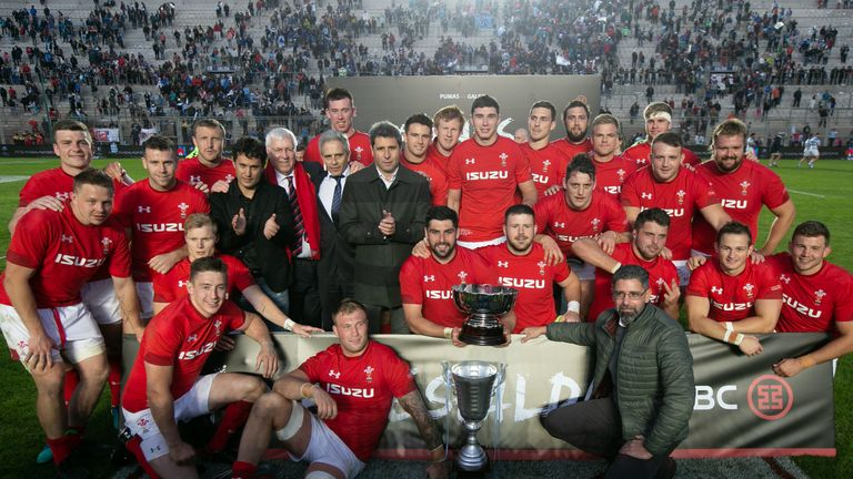 The Wales team celebrate their 23-10 victory over Argentina