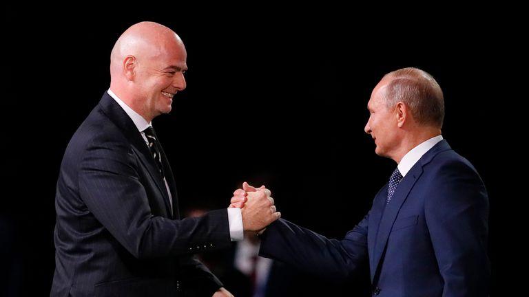 FIFA president Gianni Infantino greeted Vladimir Putin on stage