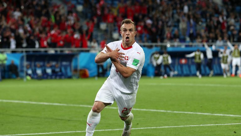 Xherdan Shaqiri celebrates his last-gasp winner against Serbia