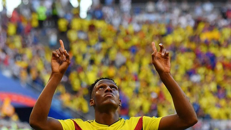 Yerry Mina celebrates after scoring the goal that sent Colombia through to the knockout stage of the World Cup