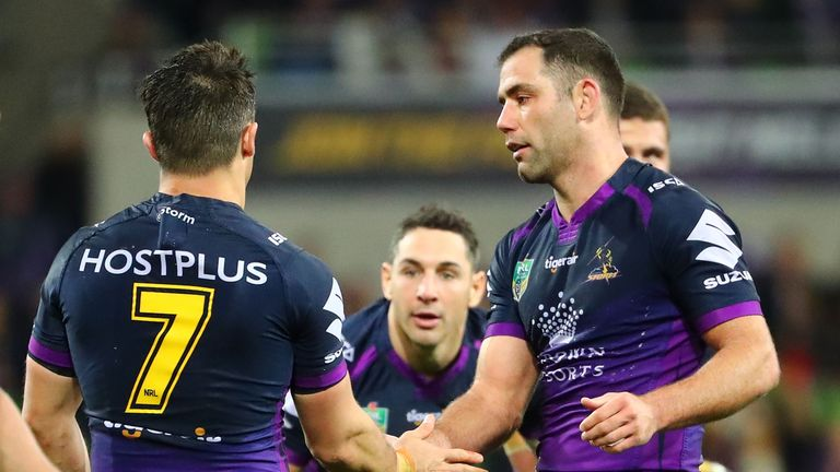 Cooper Cronk is congratulated by Cameron Smith after he played his final home match for Melbourne against the Raiders last season