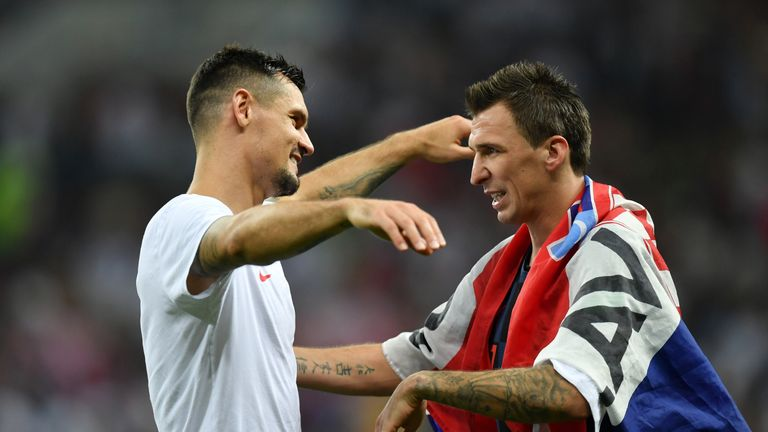 Lovren celebrates with Mario Mandzukic, whose extra-time goal fired Croatia into the final
