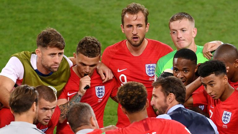 Gareth Southgate speaks to his players at the end of normal time