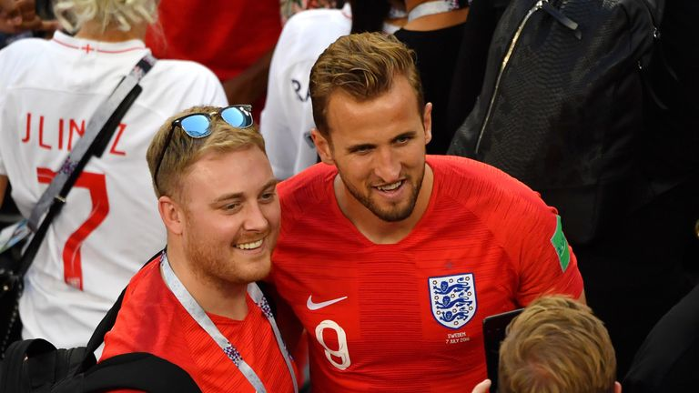 Kane poses for pictures with fans after England's win over Sweden