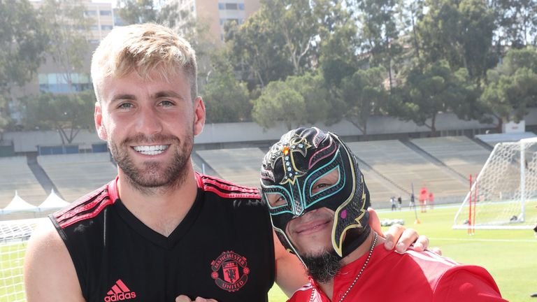 Manchester United's Luke Shaw shakes hand with Mysterio