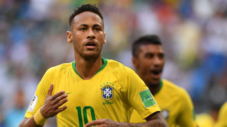 Neymar celebrates scoring the first of Brazil's two goals against Mexico