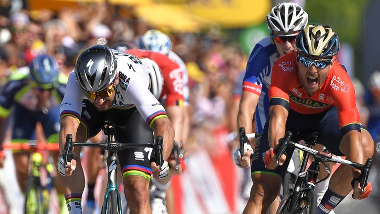 Sagan (left) holds off Sonny Colbrelli to win stage two by half a wheel