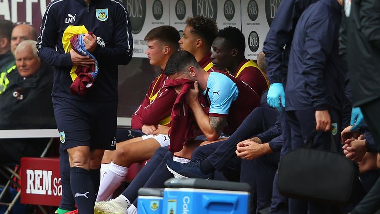 Robbie Brady of Burnley looks dejected after coming off in the first half