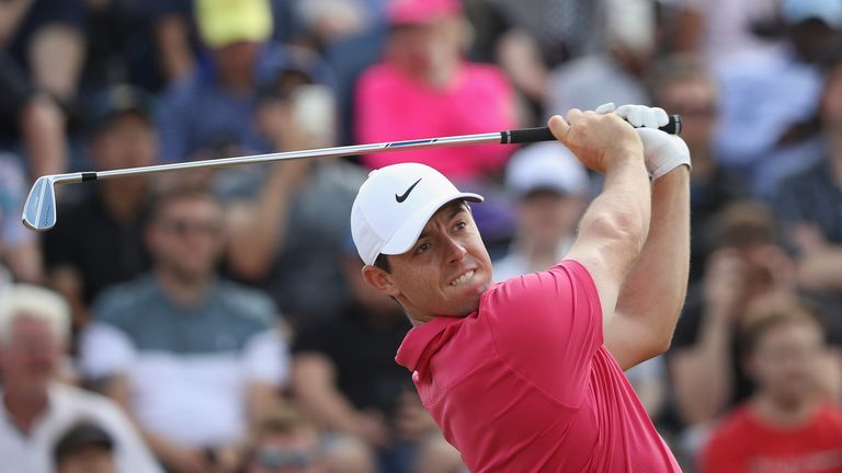 Woods fell away just as McIlroy jumped into a share of the lead with four to play