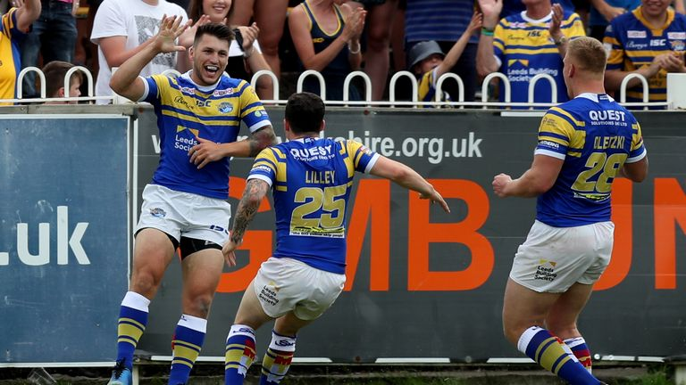 Tom Briscoe celebrates scoring the first try of the game
