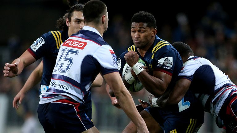 Waisake Naholo of the Highlanders fends off the Rebels' Jack Maddocks