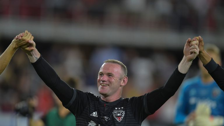 Wayne Rooney celebrates scoring his first goal for DC United