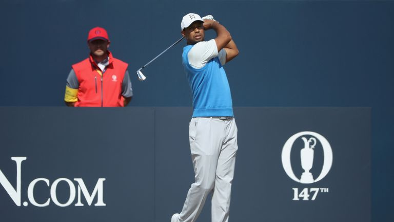 Tiger Woods tees off during his opening round