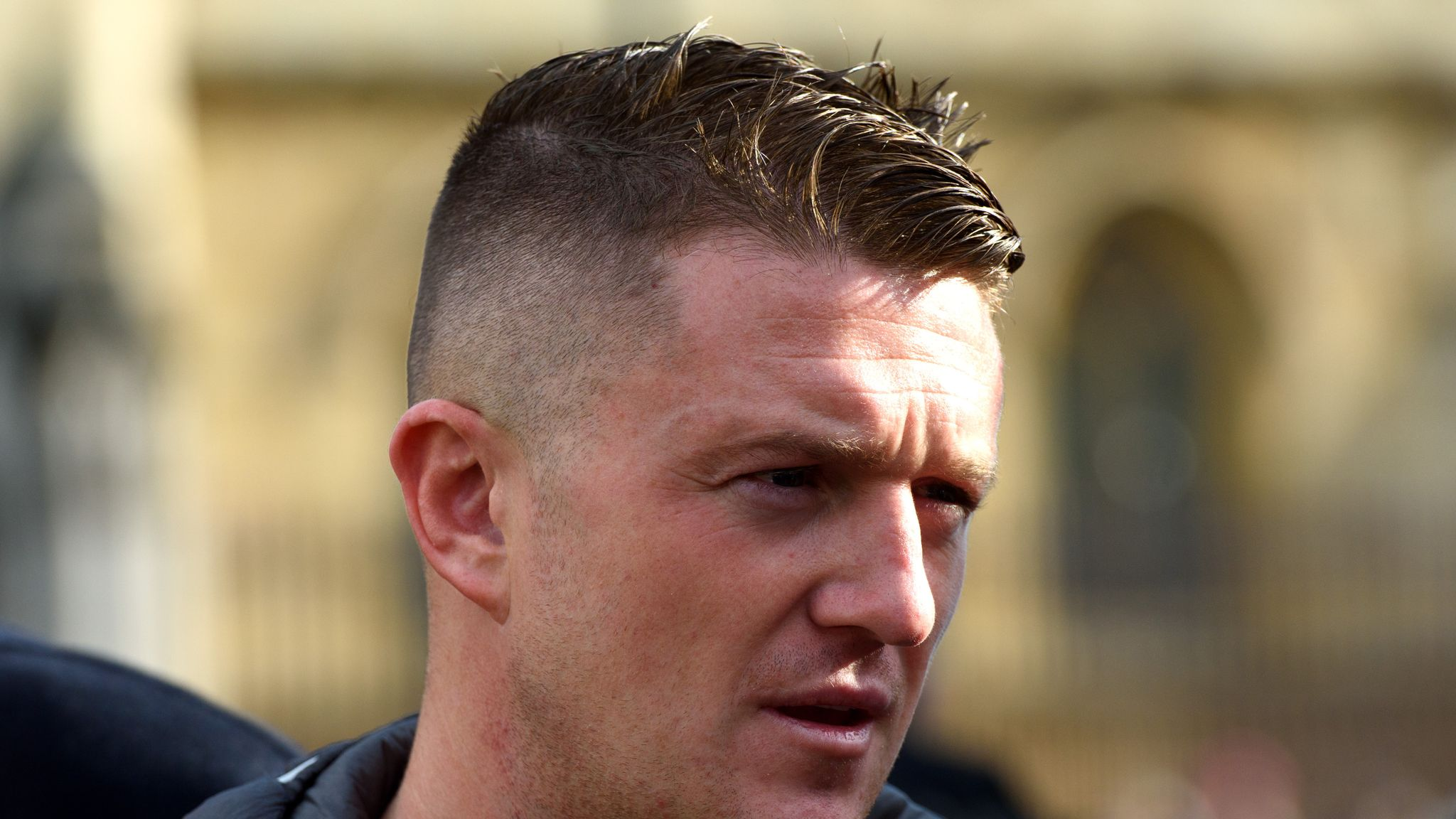 Tommy Robinson in court in attempt to avoid football ban