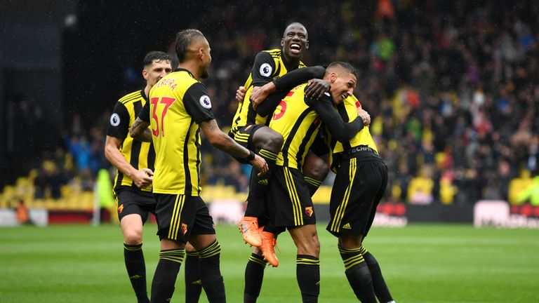 Jose Holebas is mobbed by team-mates after putting Watford 2-0 ahead