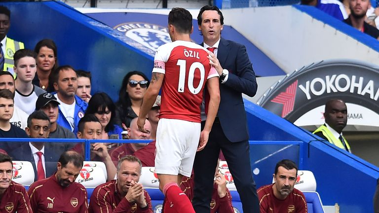 Unai Emery (right) is hoping to reap the benefit of Mesut Ozil's international retirement