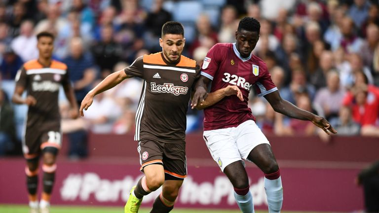 Axel Tuanzebe battles for possession with Neal Maupay