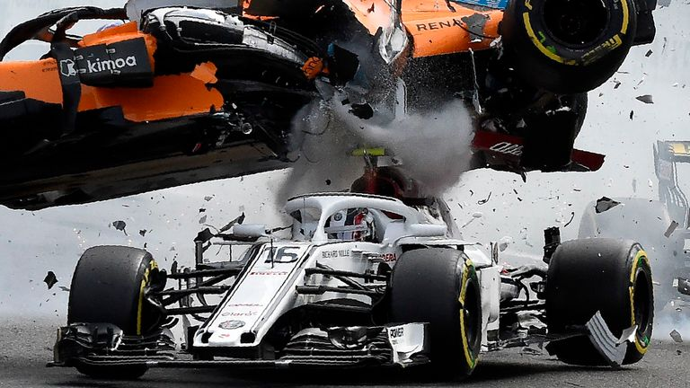 Fernando Alonso's McLaren car, hit from behind at the start of the Belgian GP, bounces off the halo on Charles Leclerc's Sauber. The safety device was made mandatory on all F1 cars at the start of 2018. Picture by Mark Thompson, Getty Images.