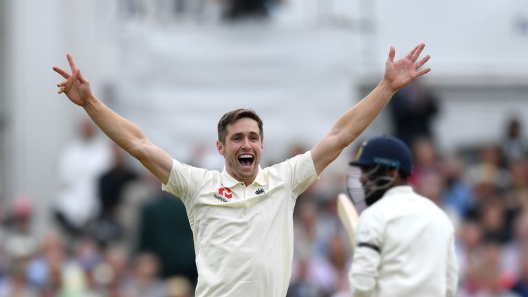 Chris Woakes celebrates taking a wicket against India in the third Test
