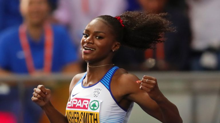 Dina Asher-Smith celebrates winning the gold medal in the women's 200m final
