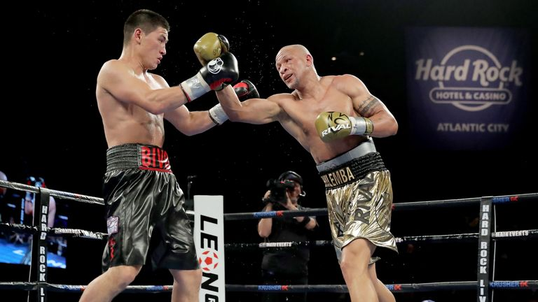 Dmitry Bivol (left) has won all 14 of his professional bouts