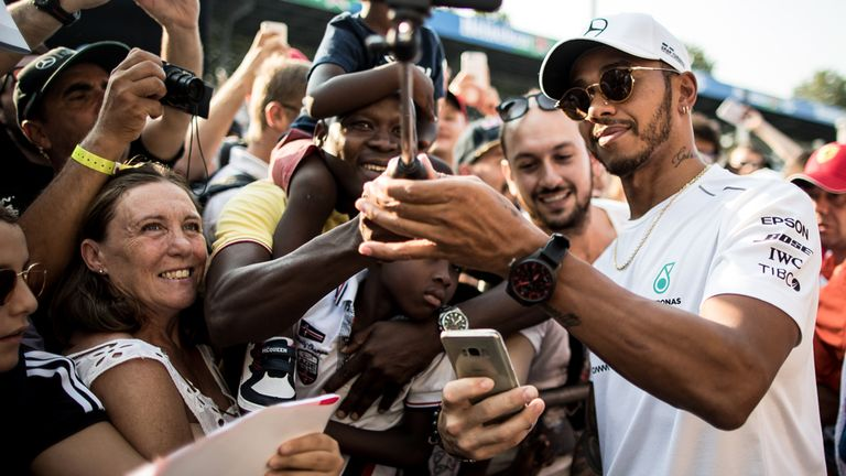 Hamilton immediately greeted the fans after his late arrival at Monza
