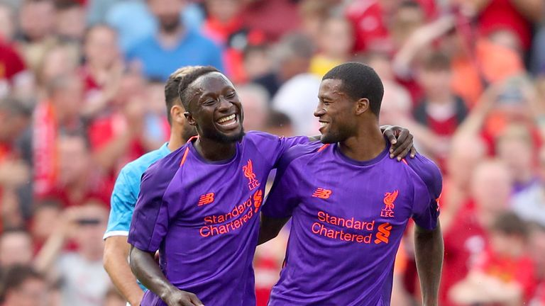 Georginio Wijnaldum (R) celebrates scoring with Naby Keita