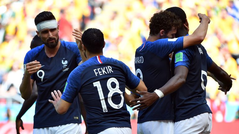 Olivier Giroud and Nabil Fekir in action for France