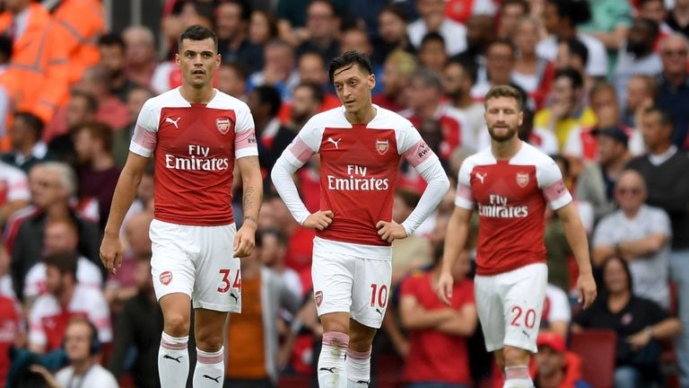 Arsenal's Granit Xhaka, Mesut Ozil and Shkodran Mustafi look on during the 2-0 home defeat to Manchester City