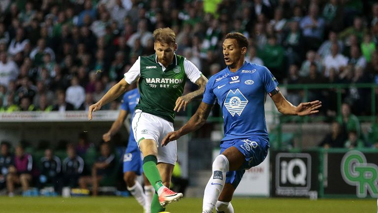 Hibernian's Martin Boyle (left) battles for possession with Molde's Ruben Gabrielsen