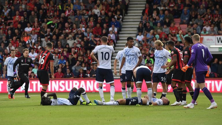 Keane lies injured after the clash with team-mate Gueye