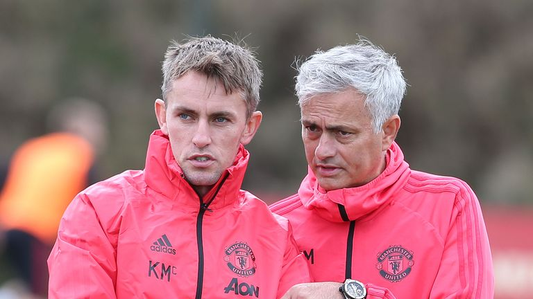 Manchester United first team coach Kieran McKenna in discussion with manager Jose Mourinho during a training session at the club's Aon Training Complex