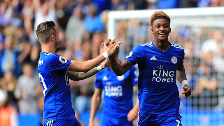 Demarai Gray celebrates with Marc Albrighton after Leicester's opener