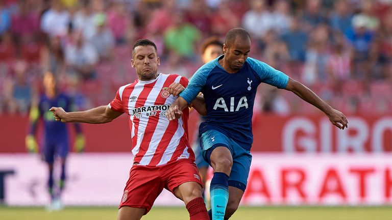 Lucas Moura and Alex Granell battle for the ball during a pre-season friendly