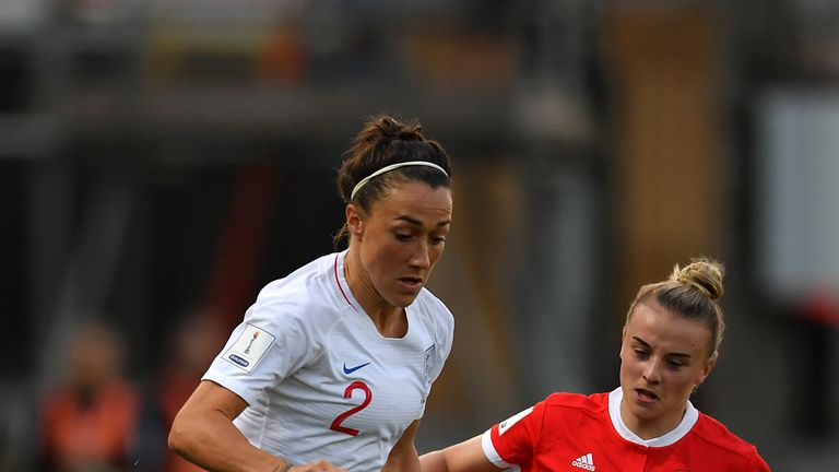 Lucy Bronze holds off Kylie Nolan