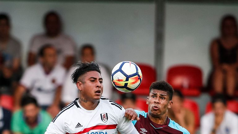 Marcelo Djalo (L) challenges Ashley Fletcher during the pre-season friendly between West Ham and Fulham
