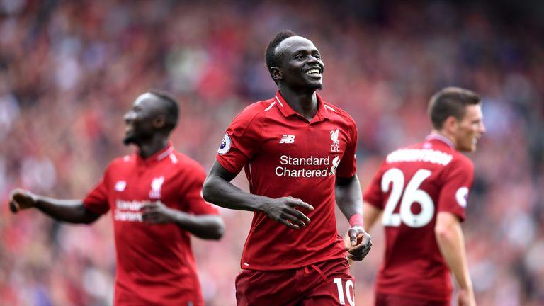 Sadio Mane celebrates scoring his Liverpool's third goal
