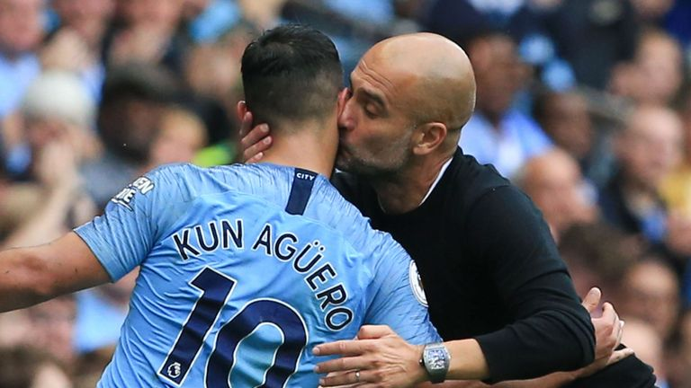 Pep Guardiola kisses Sergio Aguero after his hat-trick against Huddersfield