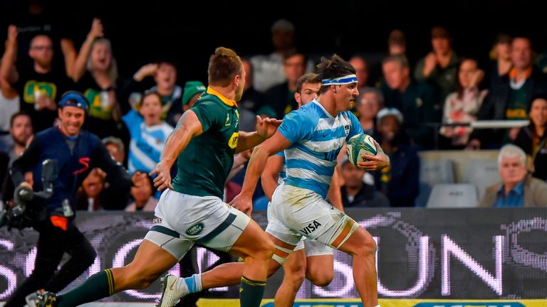 South Africa's inside centre Andre Esterhuizen (L) chases Argentina's flanker Pablo Matera (R) during The Rugby Championship rugby union match between South Africa and Argentina at Johnson Kings Park Stadium in Durban on August 18, 2018.