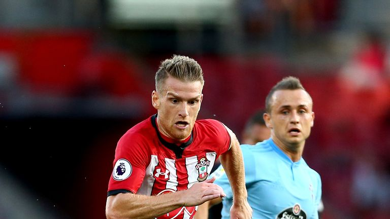 Steven Davis and Stanislav Lobotka battle for the ball during Southampton v Celta Vigo