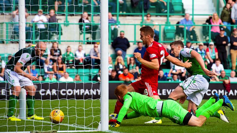 Aberdeen's Tommie Hoban forces home the opener
