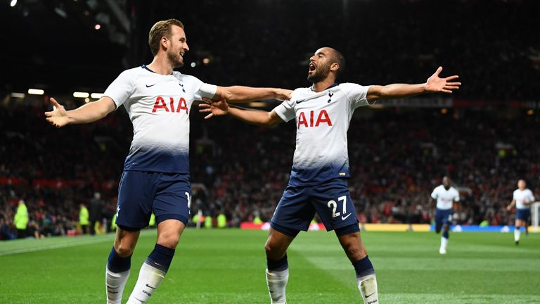 Goalscorers Harry Kane and Lucas Moura celebrate at Old Trafford