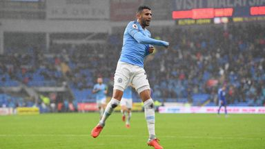 Riyad Mahrez celebrates after scoring Man City's fifth goal against Cardiff on Saturday